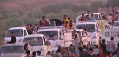 ISIS Terrorist Group Continues Conquering Towns in Iraq. This photo shows people fleeing from the advancing ISIS army.