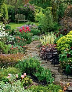 Tile path in cottage garden....beautiful flag stone garden path, curving thru a gorgeous garden!!