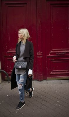 Ripped jeans, black sneakers, oversize sweater + black coat