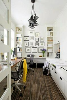 This a very modern home office. All in white and the black chairs give it a more professional look. The storage inside the walls is the perfect idea for saving space as the office is not too large, but it is clever and professional. Perfect for those who work many hours at home.