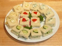 https://www.youtube.com/watch?v=QEVQRURC5OE These mouthwatering finger sandwiches are great for any picnic or party. The flavored cream cheese spread with