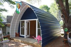 Arched Metal Cabin | Timber Trails: Turnkey tiny house, cabin kits, and custom cottage designs built of super-efficient, affordable, and easy-to-finish structural insulated panels (SIPs). Go to >> TimberTrails.TV