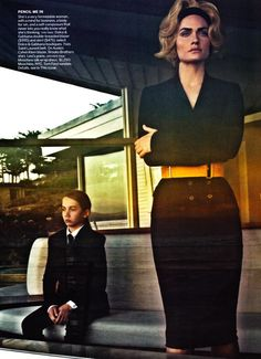 Love the black belted skirt suit.  Vogue US March 2011.