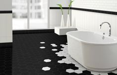 the hexagon tiles of different color make it seem like the bathtub is a glass of milk that is overflowing.