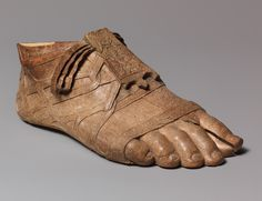 Sandaled foot, Augustan, late 1st century B.C.–early 1st century A.D.  Roman  Ivory  Overall 2 3/8 x 5 5/8 in. (6 x 14.3 cm)  Gift of John Marshall, 1925 (25.78.43)