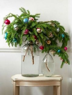 evergreen branches with colorful Christmas ornaments