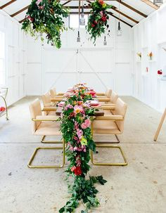 Whether they're filled with roses & ranunculus or eucalyptus & magnolia, these floral runners are about to give your wedding reception a major upgrade.