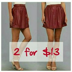 """💛 SALE 💜😚HP🌟🎀 for City Chic party Faux leather mini skirt in rhododendron/ burgundy / red with a subtle sheen. Gold-tone metal studs set off the fixed waist. Concealed zip closure at left side. Straight hemline. Skirt in size L has bunched fabric at the waist, see pic #4.  Details: 100% polyurethane - Size M: waist 28"""", length 15"""" Size L: waist 30"""", length 16"""". Ali & Kris Skirts Mini"""