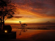 Sunset at Qunci Pool Villas on the Indonesian island of Lombok, looking across the Lombok Straight to Mount Agung on the Island of Bali.