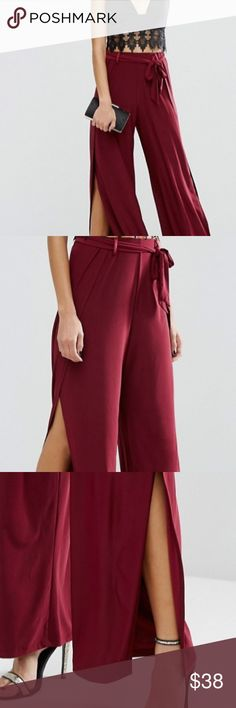 ASOS Slinky Wide Leg Pant with Split and OBI Tie This flowy pant makes a huge statement with a wide leg in a deep burgundy color WHILE BEING EXTREMELY COMFORTABLE. The slinky stretch fabric and high-rise waist give you freedom to move aroud make a statement and not have to worry about a wardrobe malfunction! The belted tie waist and thigh splits make for a head turning look. Pair with a basic black top and strappy sandles and you're ready for a night out! ASOS Pants Wide Leg