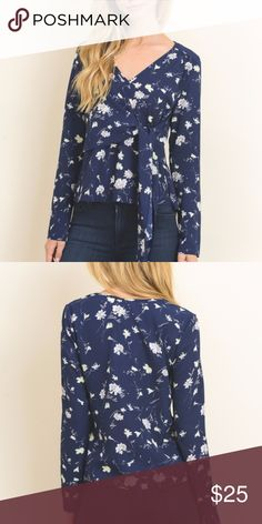 Long Sleeve Floral Top Navy Blue with Cream colored floral pattern.  Faux wrap with bow at waist.  Long straight sleeve.  Large measures approx. 40 bust and shoulder to hem is approx 23 in. True to size. No stretch.100% polyester, hand wash, lay flat to dry. Le Lis Tops Blouses