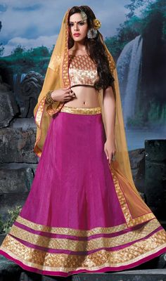 Look ethereal in this pink color embroidered satin and lycra choli skirt. The ethnic lace and resham work on the choli adds a sign of attractiveness statement with your look. #embroideredlehengacholi #magentacolorlehengacholie #lehangaskirtcholis