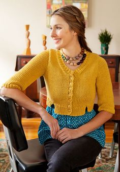 Knitting Pattern. Fitted and cropped, Gardner is the perfect cardigan to wear with an empire waisted dress or blouse. Notches in the front and a multitude of buttons add visual interest.