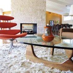 Love the glass coffee tabletop!modern living room by Tara Bussema