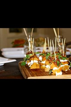 Rosemary roasted beet stacks layered with goat cheese and topped with pea shoots and fried shallots. So good!!