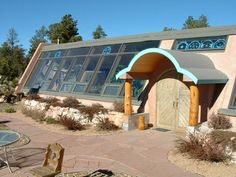 Earthship -  Alternate design. Awesome article about design and functionality of the completely self sustainable home