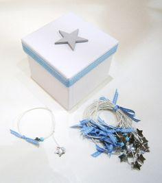 Περιγραφή: Μαρτυρικό βραχιολάκι με λευκό κερωμένο κορδόνι, γαλάζια αδιαφανή χάντρα, ασημένιο αστεράκι, τετραγωνισμένο σταυρό και φιογκάκι από γαλάζια γκρο κορδέλα με λευκά εξώραφα. Το κουτάκι είναι προαιρετικό. Decorative Boxes, Home Decor, Decoration Home, Room Decor, Interior Design, Home Interiors, Interior Decorating