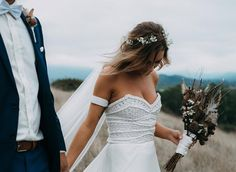 In AWE of this stunning moment captured by @enchanted_weddings of @rhiannon.abrahams hand in hand with her hubby @jbizzy_14 on their special day ✨💫👌💫✨👏 #denissemvera #custom #macramé #silk #weddingdress #bride #bridal #bohobride