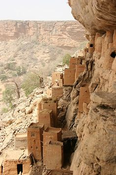Cliff dwellings on the Bandiagara escarpment in the Sahel region, Dogon country of Mali.  There are dozens of villages along the cliff.  The UNESCO World Heritage Site has been occupied since the 14th century.  by Ferdinand Reus