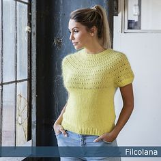 Kastellet is a gorgeous knitted top for summer and spring. The beautiful yellow colour and lovely round yoke with the charming eyelet pattern makes the design almost irresistible.