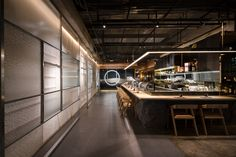 © Seth Powers. SOZO, Japanese food restaurant in Chengdu, China. By Ahead Design. Entry way.