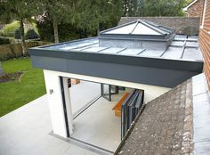 orangery with skylight and bifolding doors Bungalow Extensions, Roof Lantern, Urban Interiors, Orangery, Bifold Doors, Roof Design, Zinc Roof, Garden Room Extensions, Lantern Roof Light