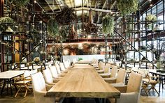 this interior renovation in bangkok saw a previous tractor warehouse converted into the 'vivarium restaurant' in bangkok. designed by thai multidisciplinary design agency- hypothesis, the strategy they adopted led to the creation of a meaningful dialogue between the old and new elements within the warehouse setting. the character of the building has been kept intact, with majority of the interior left unchanged.
