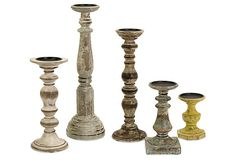 HOME DECOR – ILLUMINATION – CANDLE PILLAR – Distressed Candleholders. This set of wood candleholders, in varying heights and distressed finishes, look as if it's been plucked from an antique market.