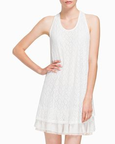 such a fun and lightweight dress. Love that it's white, so you can layer just about any color accessories with it.