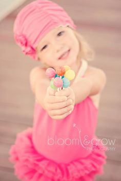 Lollipops, flowers, or anything really that a little girl wants to show off