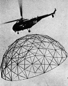 A helicopter airlifting one of Buckminster Fuller's geodesic domes.