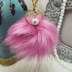 Lilac Faux fox fur pom pom keychain with pearl NWOT! Brand new!! Faux fox fur but really soft and great quality. Gold hardware.  Size: (approx) Ball Diameter = 8cm  Its a keychain, you can also use it to put as purse charm or just to hold any key.  Great gift for your family, friends or your self.  ** color might be slightly different cause of the lightning  Great for your Louis Vuitton, Prada, Fendi, Chanel, Michael Kors, Gucci, Coach Tory Burch, Kate spade, Marc jacobs and others…