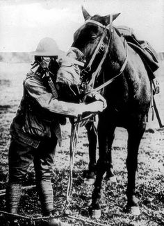 An American soldier demonstrates gas mask protection on himself and his horse in 1917.