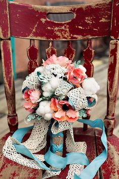 salmon and teal/aqua wedding arrangement with cotton and lace