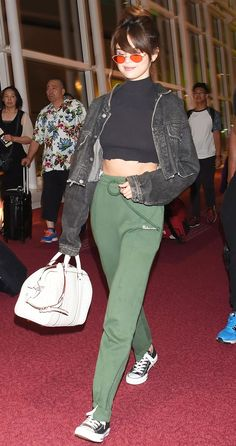 Selena Gomez Touches Down in Tokyo Wearing a Crop Top and Too-Cool Sweatpants from InStyle.com