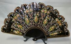Very interesting meticulously carved Spanish Fan with design with yellow, white and green flowers