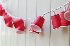 a really easy party decoration, mini red solo cup garland that lights up!