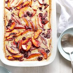 Peach and Raspberry Clafoutis, add a little whipped cream and you're in heaven!!