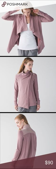 Lululemon Coast Wrap Heathered Mod Chalky Rose, 12 Beautiful wrap in a rare color! Size 12. Great condition except for 2 very small spots (pictured). Wear this relaxed layer open & loose when we're feeling breezy after class. Once you cool down, wrap it up & fasten the buttons on the inner & outer collar.Instant coziness! -super-soft Modal fabric is 4-way stretch -stash your stuff in the front pockets -media pocket w/ cord exit so you don't get tangled -thumbholes help keep sleeves down…