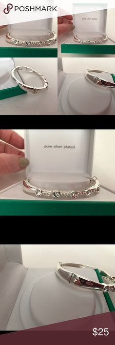 Sparkle Allure Crystal Pure Silver Plate Bracelet This is a beautiful silver plated bracelet. Has 5 round crystal stones across front. Has a snap open and close. Easy to get on. Measures 2 5/8 inches across. Will fit approximately up to a 6 inch wrist. Sparkle Allure Jewelry Bracelets