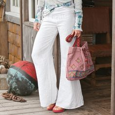 "LINEN PALAZZO PANTS -- Wide legs of soft, garment-dyed linen flow from a stretchy knit waistband to roll as you like. Machine wash. Made in the USA. Sizes XS (2), S (4 to 6), M (8 to 10), L (12 to 14), XL (16). 32-1/4"" inseam."