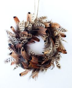 three of these for my kitchen? ;) mY husband says YES. Christmas ornament wreath -Tree Ornament - Wreath- Feather mini wreath $9.99
