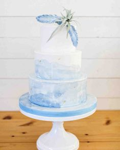 The Prettiest Ombré Wedding Cakes for Couples Who Love Color | Martha Stewart Weddings - We loved how this creation's cake stand served as a continuation of the swirly blue ombré. The sugar feathers, air plant, and gold flecks were finishing touches. #ombre #weddinginspiration #weddingcake #cakeinspiration
