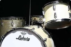 Ludwig vintage drum set: WLF 'Buddy Rich' Super Classic Outfit.  Sizes: 22/14, 13/9, 16/16, and 13/3 Snare  Shells: 3-ply Mahogany with Reinforcing Rings.  Finish: Original White Marine Pearl