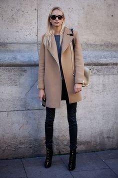 Black jeans, coat, gray sweater.
