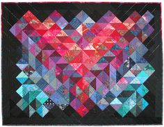 Triangles and Beads by Ann Fahl. The quilt is embellished with matching iridescent bugle beads that are stitched in diagonal lines.