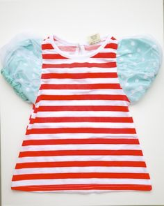 Perfect for your sweet and sassy little girl.   Features light blue puffy tulle sleeves and jersey knit red and white striped top.    Comes in size 2T to 6.