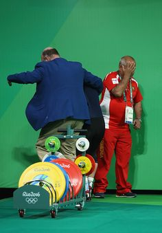 #RIO2016 Andranik Karapetyan of Armenia reacts to an injury during the Men's 77kg Group A weightlifting contest on Day 5 of the Rio 2016 Olympic Games at...