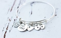 Custom Sterling Silver Adjustable Bangle with a family tree charm and hand stamped disc and hearts suck a beautiful design. You can order one at www.Facebook.com/CoreyTreacyDesigns Bangles, Bracelets, Metal Stamping, Hand Stamped, Hearts, Charmed, Facebook, Sterling Silver, Accessories