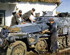 Sdkfz 251 getting its winter coat washed off.: